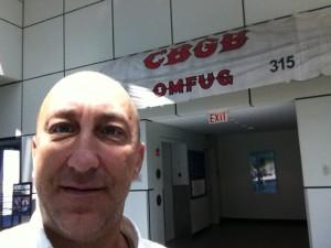 John Lamb in front of the CBGB 's exhibit @ the R & R HOF